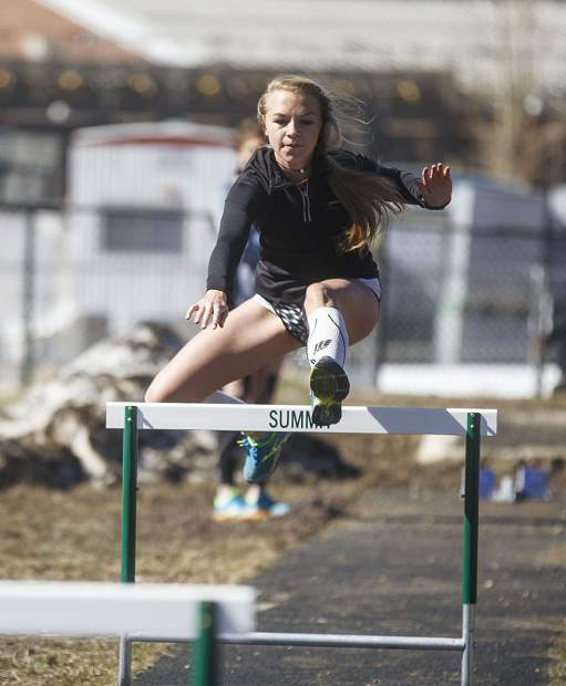 Hunter Stimson hurdles during track practice at Summit High School Wednesday, April 25, in Breckenridge.