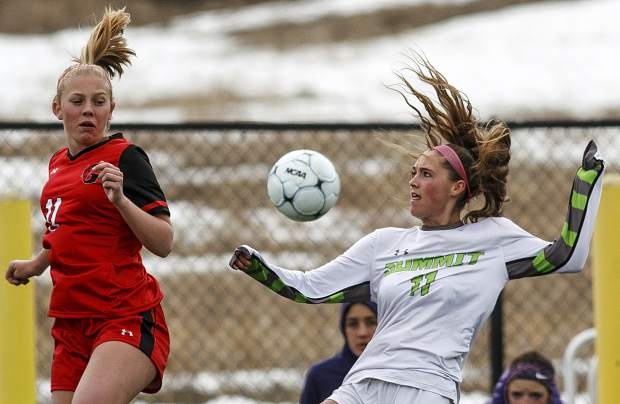 Summit High School senior midfielder Shannon Hogeman, right, attempts to control the ball during the home match against Glenwood Springs High School Thursday, April 5, at Climax Molybdenum Field at Tiger Stadium.