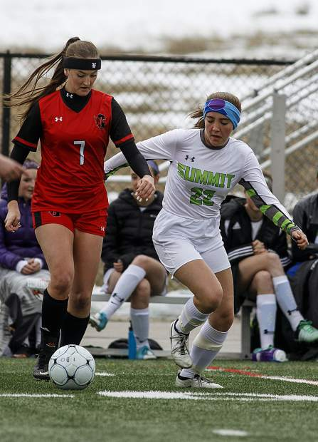 Summit High School sophomore Nicole Kimball, right, attempts to steal the ball during the Tigers' home match against Glenwood Springs High School Thursday, April 5, at Climax Molybdenum Field at Tiger Stadium.