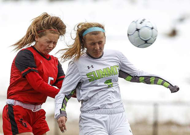 Summit High School senior Haleigh Lecklitner, right, heads the ball against Glenwood Springs High School freshman Tatum Lilly during the Tigers home match Thursday, April 5, at Climax Molybdenum Field at Tiger Stadium. Catch up on the past week's Summit High School girls sports action via our weekly recap on page 18.