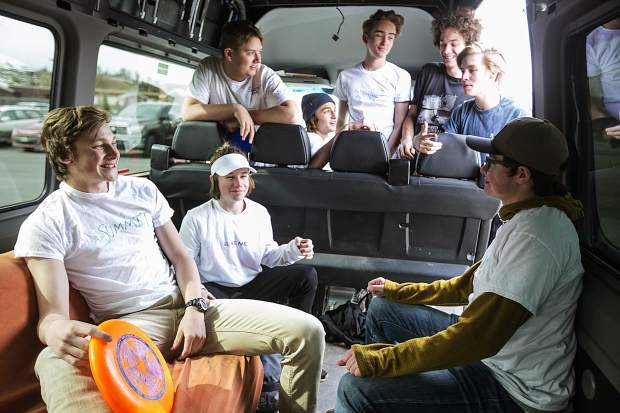 Summit High School ultimate frisbee players interact inside the unofficial team van before practice Thursday, April 12, at school grounds in Breckenridge.