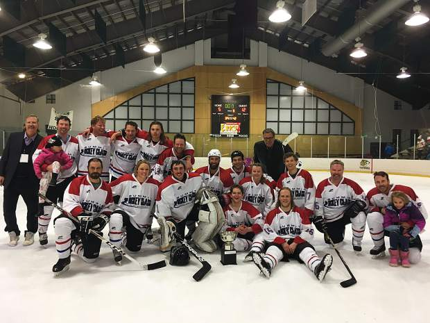 Team Beaver Run poses for a celebratory photo after winning the 2018 Summit Hockey Classic on Saturday April 7, 2018