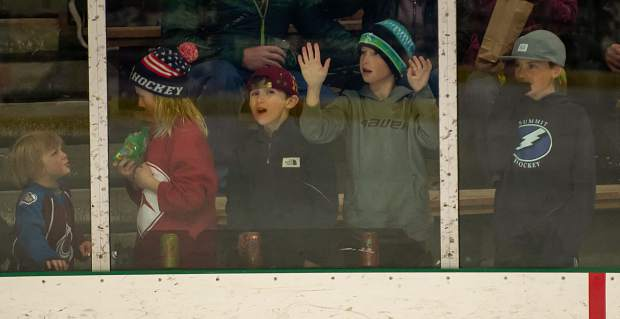 Young fans cheer and react to the action on the ice through the plexiglass boards at this past weekend's 21st annual Summit Hockey Classic.