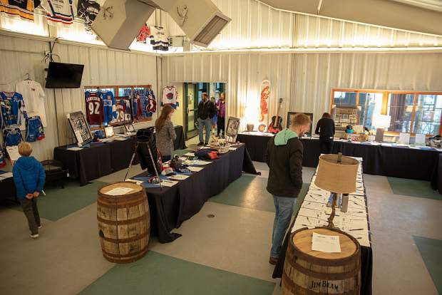 Attendees at this past weekend's 21st annual Summit Hockey Classic in Breckenridge peruse the items up for auction.