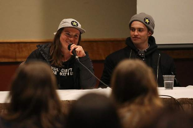 2018 Pyeongchang Olympic snowboard halfpipe bronze medalist Arielle Gold, who resides in Breckenridge, speaks while Eagl-Vail Olympic halfpipe snowboarder Jake Pates listens Sunday at the Olympian and Paralympian meet-and-greet event to kick-off the 2018 USASA Junior Nationals at Copper Mountain Resort, which run through April 11.