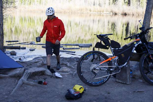 Zach Husted demonstrates bikepacking while at Rainbow Lake on Tuesday, May 15 in Frisco. Husted went on an 11-day, 539-mile trip on and around the Colorado Trail via his mountain bike late last September.