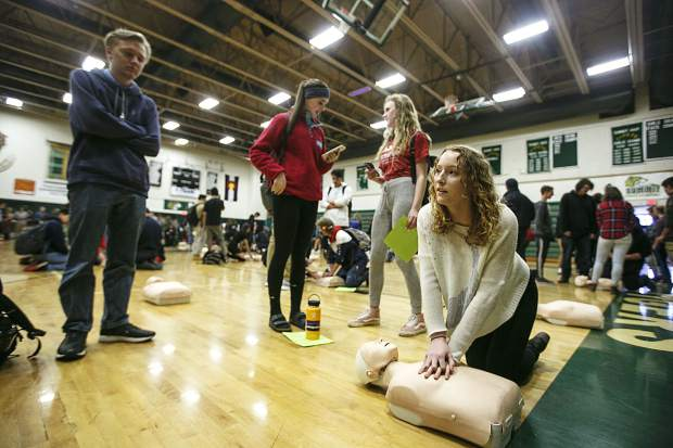 Summit High School students take turns performing CPR during the second annual Hands Only CPR day Thursday inside the school's gymnasium in Breckenridge.