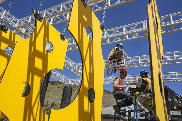 Copper Mountain employees construct the features on the upper frame of the Wrecktangle obstacle course Friday, May 25, at base of the the resort.