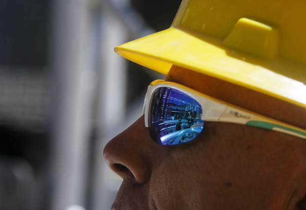 The Wrecktangle obstacle course reflected in the sunglasses of a construction crew member Friday, May 25, at base of the the resort.