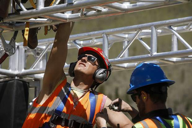 Copper Mountain employee Rob Beshures construct the features on the upper frame of the Wrecktangle obstacle course Friday, May 25, at base of the the resort.