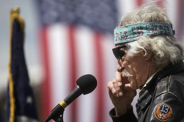 World War II veteran fighter pilot Boot Gordon wipes a tear with his hand during a speech in front of the crowd remembering his fallen colleagues Memorial Day, Monday May 28, at the Dillon Cemetery.