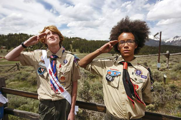 Summit County Boy Scout Troop 188 members salute during the flag retirement process during Memorial Day ceremony Monday, May 28, at the Dillon Cemetery.