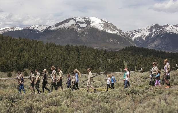 Summit County Boy Scout and Cub Scout members walk during the Memorial Day ceremony Monday, May 28, at the Dillon Cemetery.