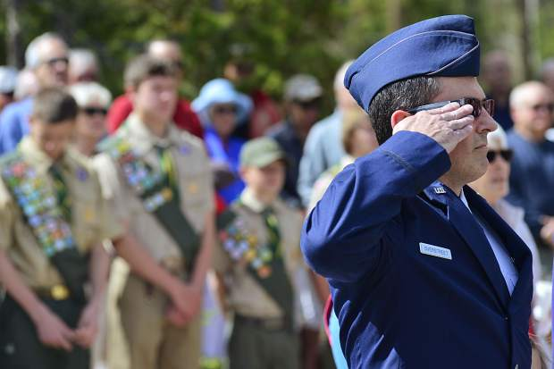 Major Darin Overstreet, deputy state public affairs officer with the Colorado National Guard, salutes the flag Monday during the sixth Memorial Day Commemoration at Valley Brook Cemetery in Breckenridge.