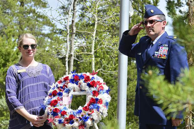 Major Darin Overstreet, deputy state public affairs officer with the Colorado National Guard, salutes the fallen after laying a wreath with Breckenridge Councilwoman Elisabeth Lawrence on Monday during the sixth Memorial Day Commemoration at Valley Brook Cemetery in Breckenridge.