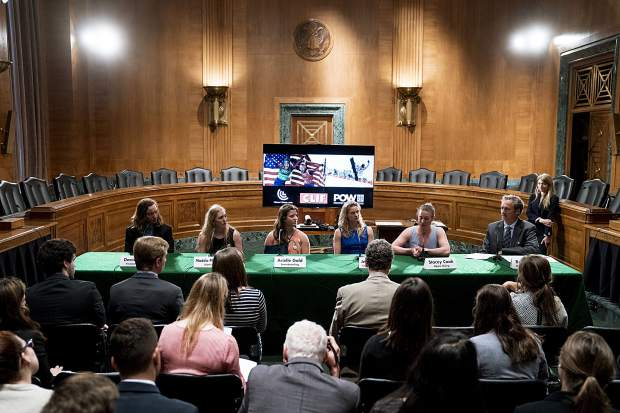 From left, Winter Olympians freestyle skier David Wise, biathlete Maddie Phaneuf, halfpipe snowboarder Arielle Gold, Cross-country skier Jessie Diggins, and alpine skier Stacey Cook speak about the negative impact climate change is having on winter sports, Wednesday, April 25, 2018, in Washington.