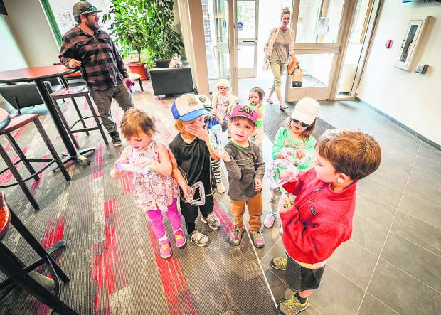 Children hang out in the lobby of the Breckenridge Recreation Center on Tuesday as the town unveiled the second wave of new additions tied to a $17.2 million renovation project at the facility, including a new children's wing with an indoor playground.