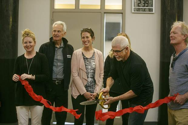 Breckenridge Mayor Eric Mamula cuts the ribbon on a $17.2 million rennovation of Breckenridge Recreation Center on Tuesday, May 22, at the facility.