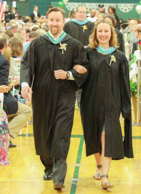 Summit High School Principal Drew Adkins and Vice Principal Tessa Rathjen lead the students into the gymnasium for the graduation ceremony Saturday, May 26, in Breckenridge.