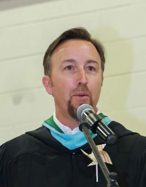Summit High School Principal Drew Adkins speak during the graduation ceremony Saturday, May 26, at the SHS gymnasium in Breckenridge.