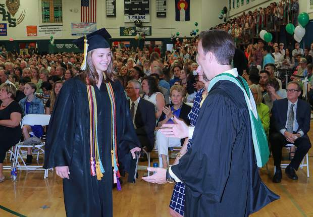 Summit High School Principal Drew Adkins greets Payton Weinman during the graduation ceremony Saturday, May 26, in Breckenridge.