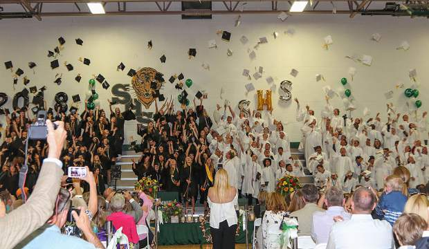 Summit High School graduates toss their caps in the air during their graduation ceremony Saturday, May 26, at the SHS gymnasium in Breckenridge.