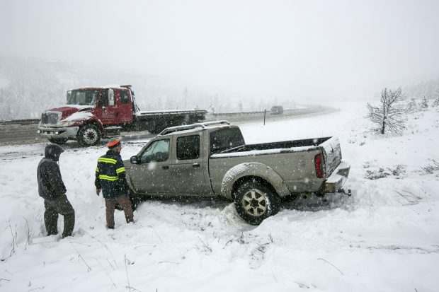 Ryan's Recovery truck works to tow a spun out vehicle along interstate 70 Thursday, May 3, in Silverthorne.