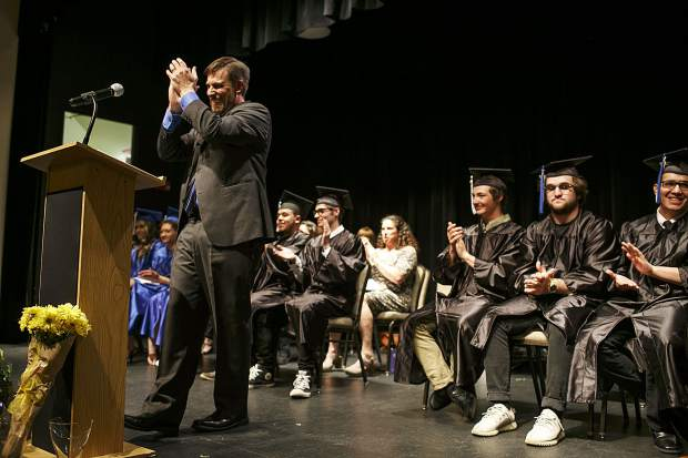 Snowy Peaks High School Principal Jim Smith applauds during a presentation in the graduation ceremony Thursday, May 24, at the Silverthorne Pavillon.