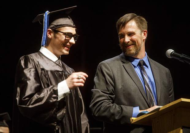 Snowy Peaks High School Principal Jim Smith looks to fellow student Brenden Penegor during the graduation ceremony Thursday, May 24, inside the Silverthorne Pavillon.