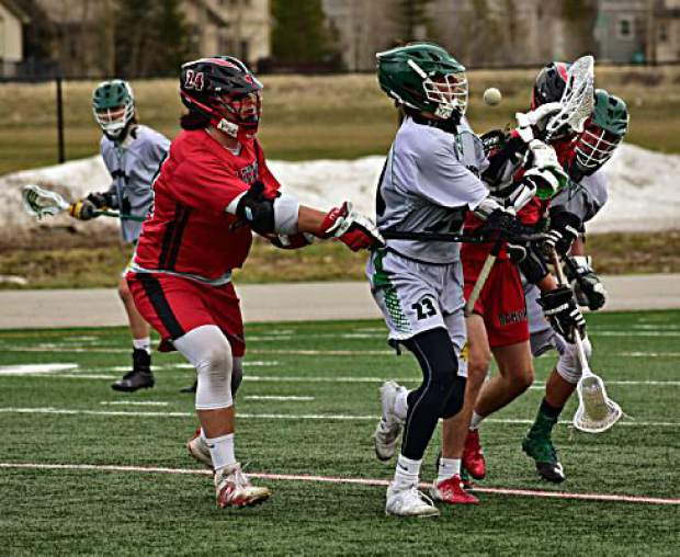 Members of the Summit High Tigers boys lacrosse team fight for a loose ball during the Tigers boys lacrosse team's 9-8 loss to Glenwood Springs on Tuesday.