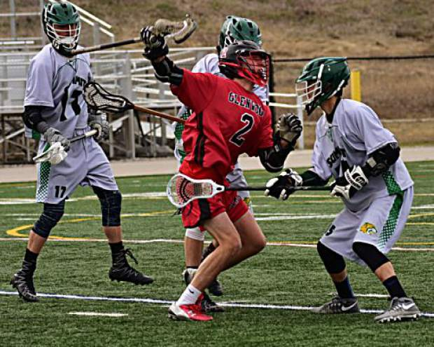 Members of the Summit High Tigers boys lacrosse team defend during the Tigers boys lacrosse team's 9-8 loss to Glenwood Springs on Tuesday.