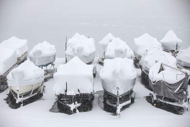 Seasonal boats stay covered in snow at the Dillon Marina Thursday.
