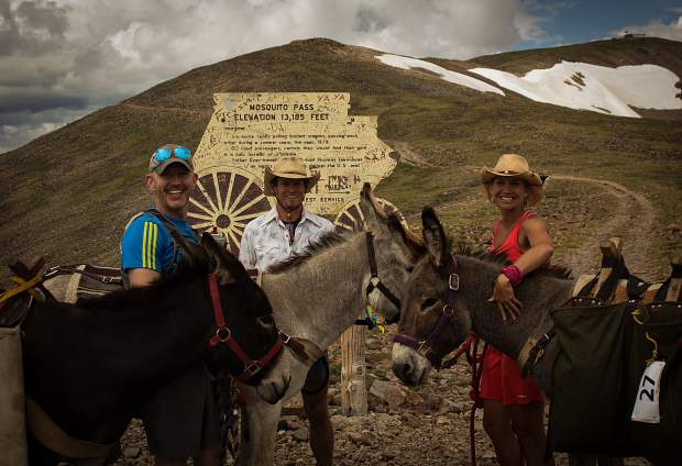 Burro racers pose for a photo alongside their burros - Spanish for