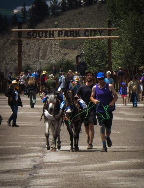 Racers depart historic South Park City with their burros - Spanish for
