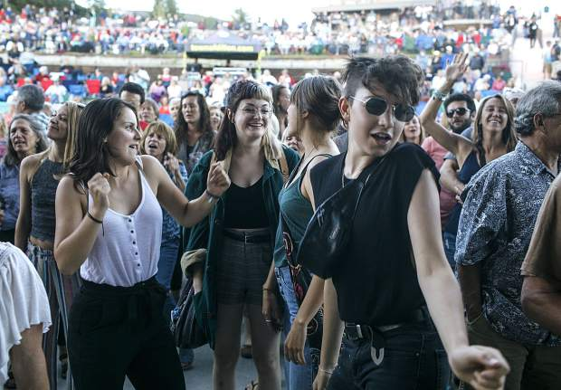 Fans dance in tune with The Nacho Men band during the Dillon Concert Series Friday evening, June 29, at the Dillon Amphitheater.