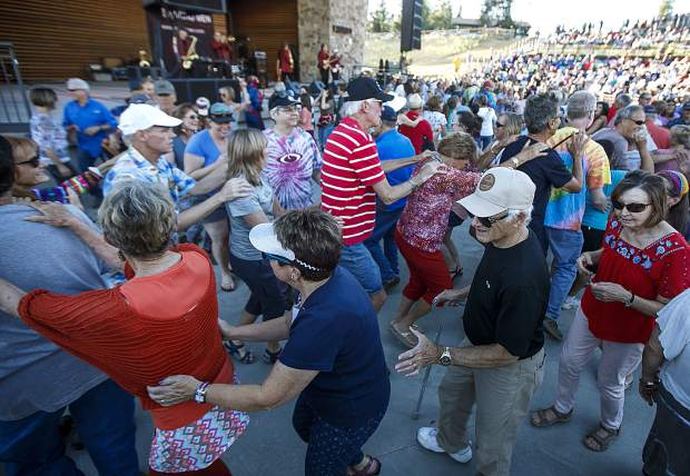 Fans collaborate in a conga line during the Dillon Concert Series Friday evening, June 29, at the Dillon Amphitheater.