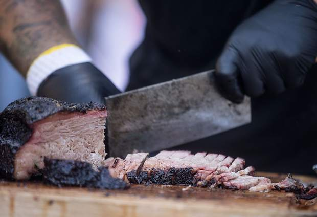 Flavored smoked meat is chopped at the Bigs Meat Wagon vendor during the Frisco BBQ event Friday, June 15, in Frisco.