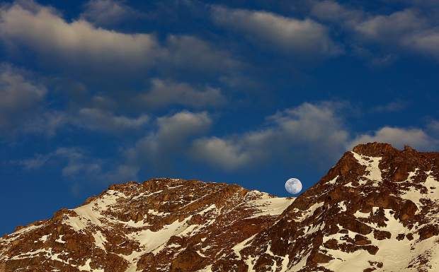 Moon rises over east wall of Arapahoe Basin.