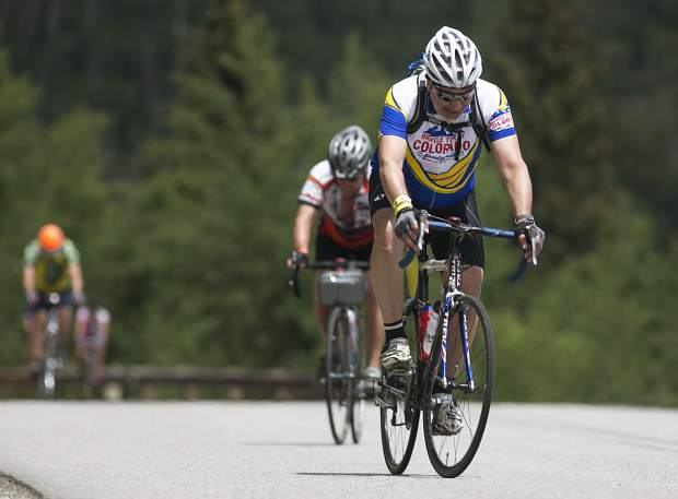 Bicyclists participating in the 33rd annual Ride the Rockies bike tour pedal on Ute Pass on Friday, June 15 near Silverthorne. Cresting the pass signified the six-day tour's return into Summit County after it departed Breckenridge on Sunday.
