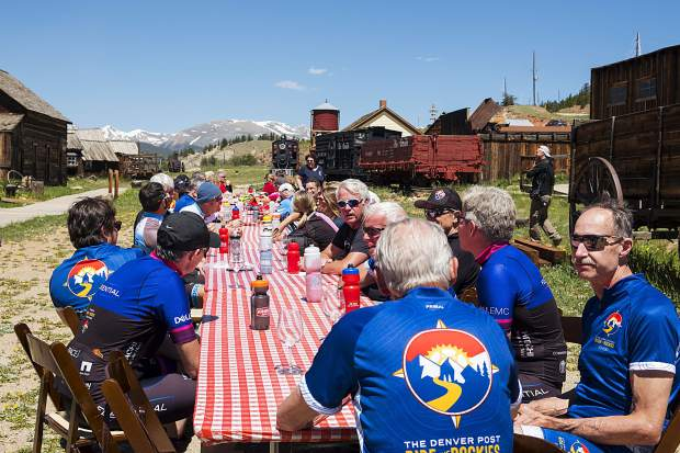 Ride The Rockies Prologue Expreience participants eat and drink in South Park City Saturday during a break from the 54 miles and 4,434 feet of elevation cycling from Breckenridge, down to Fairplay and back to the start and finish line of this year's tour.