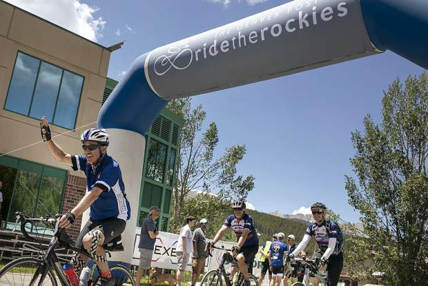 Bicyclists participating in the Ride the Rockies tour pedal through the finish line on Friday, June 15, in Breckenridge.