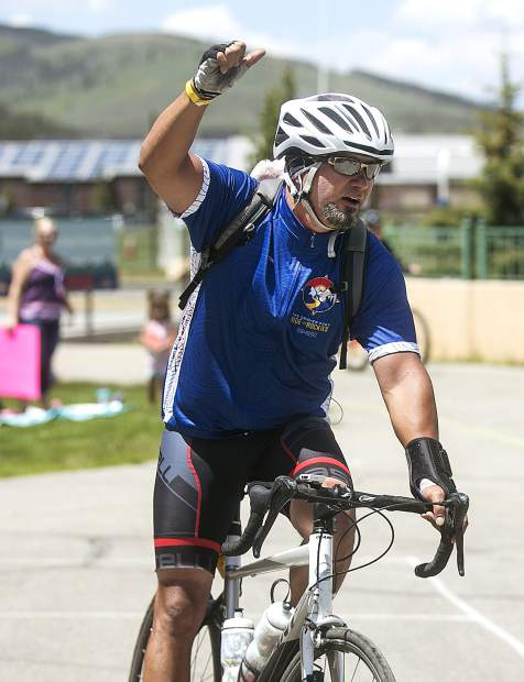 A bicyclist participating in the Ride the Rockies tour pedals through the finish line on Friday, June 15 at the Breckenridge Recreation Center.