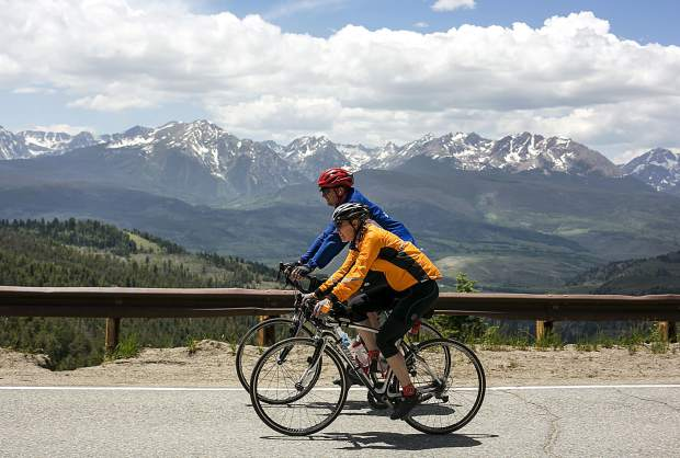 Bicyclists participating in the 6-day Ride the Rockies tour pedal through Ute Pass, with a view of the Gore Range in the background, on Friday, June 15, north of Silverthorne. The loop route consised oft 418 miles with 25,935 vertical feet of gain passing through Edwards, Steamboat Springs, Grand Lake, and Winter Park before returning to Breckenridge on Friday.