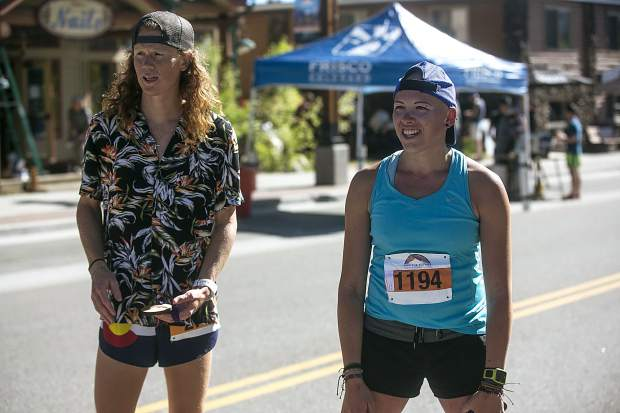 2018 Run The Rockies 10k men's champion Luke Bruns and women's champion Mandee Middleton recover following the Run the Rockies race on Saturday in Frisco.