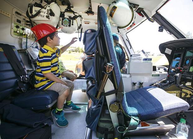 Silverthorne resident Tobias Bruning, 4, explores the interior of the Life Flight helicopter during the Safe Summer Kickoff event at Rainbow Park Saturday, June 9, in Silverthorne.