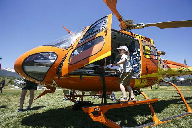Local children check out the interior of the Life Flight helicopter during the Safe Summer Kickoff event at Rainbow Park Saturday, June 9, in Silverthorne.