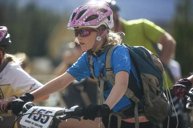 Junior Girls 10 & Under race participant Kadie Calkin gets ready to race during Wednesday evening's second event of this summer's Summit Mountain Challenge mountain bike race series, the Gold Run Rush, which took place in and around the Wellington neighborhood of Breckenridge.