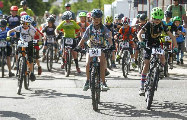 Carly Keyes (center) leads a pack of Junior Girls 11-12 participants in the Summit Mountain Challenge's second mountain bike event of this summer's series, the Gold Run Rush, which took place on Wednesday, June 20, in and around the Wellington neighborhood of Breckenridge.