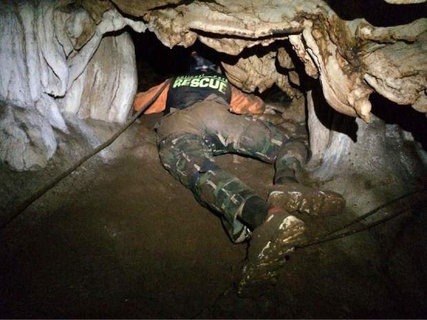 In this photo released by the Thailand Department of National Parks and Wildlife on Wednesday, June 27, 2018, rescue personnel search for alternate entrances to a cave where 12 boys of a soccer team and their coach went missing in Mae Sai, Chiang Rai, northern Thailand. Rain is continuing to fall and water levels keep rising inside a cave in northern Thailand, frustrating the search for the boys and their coach who have been missing since Saturday.