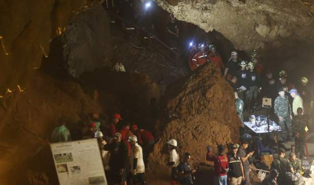 Emergency rescue teams gather in the staging area as they continue the search for 12 young soccer team members and their coach after going missing in a large cave in Mae Sai, Chiang Rai province, in northern Thailand Wednesday, June 27, 2018. Rain is continuing to fall and water levels keep rising inside a cave in northern Thailand, frustrating the search for 12 boys and their soccer coach who have been missing since Saturday.